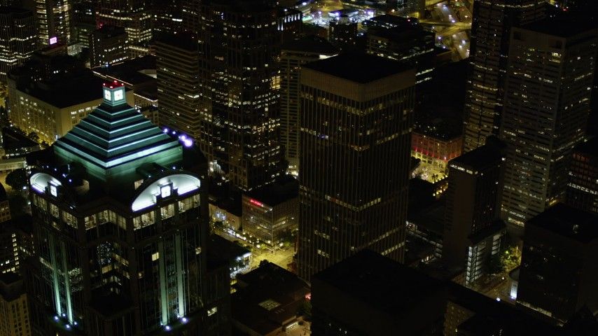 5K stock footage aerial video flyby 1201 3rd Avenue Tower to reveal base of Rainier Tower in Downtown Seattle, Washington, night Aerial Stock Footage | AX51_089
