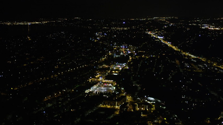 5K stock footage aerial video pass a shopping center in Rainier Valley, Seattle, Washington, night Aerial Stock Footage | AX51_095