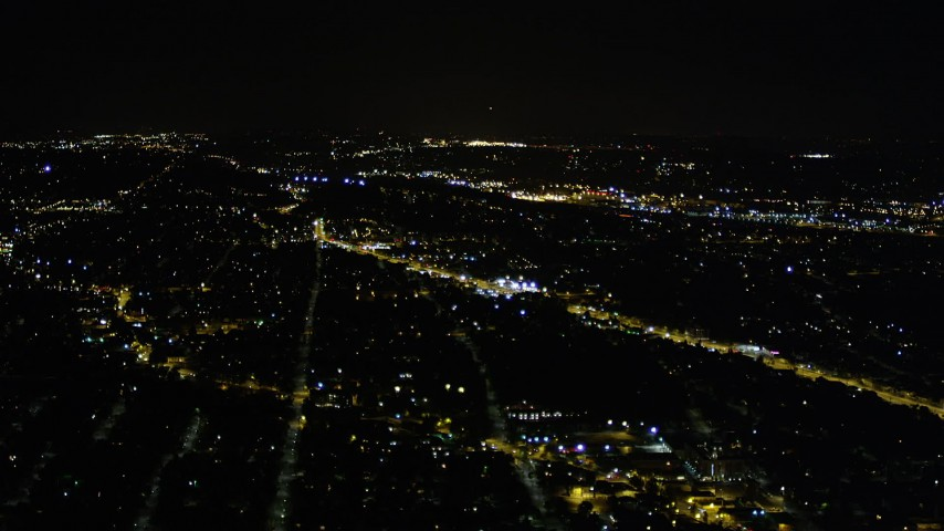 5K stock footage aerial video of suburban neighborhoods in Rainier Valley, Seattle, Washington, night Aerial Stock Footage AX51_097 | Axiom Images