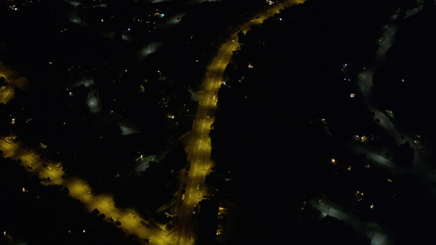 5K stock footage aerial video bird's eye view of residential neighborhoods and city streets in Rainier Valley, Seattle, Washington, night Aerial Stock Footage | AX51_098