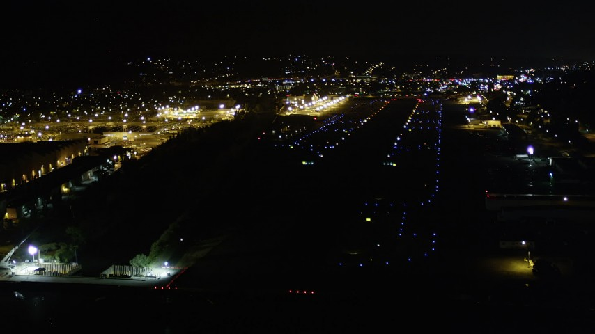 5K stock footage aerial video approach Renton Municipal Airport runway from Lake Washington, night Aerial Stock Footage | AX51_101