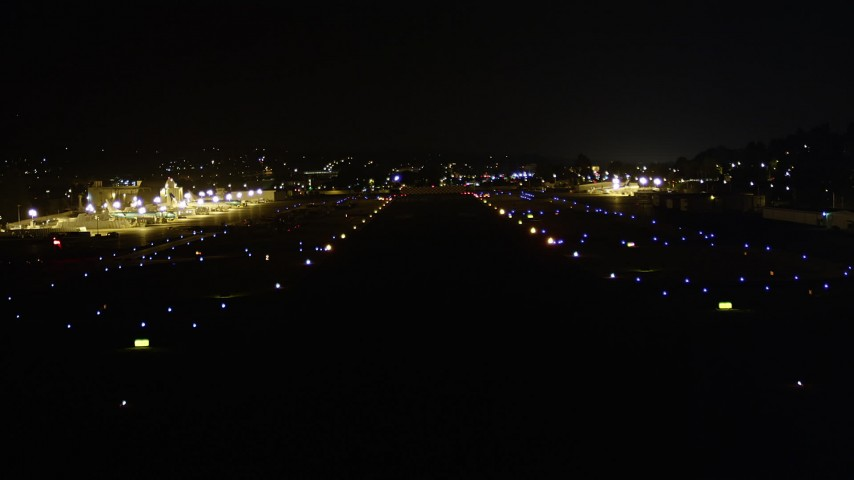5K stock footage aerial video of coming in for a landing at Renton Municipal Airport, Washington, night Aerial Stock Footage | AX51_102