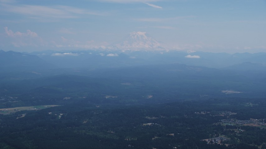 5K stock footage aerial video of Mount Rainier with snow, an active volcano in Cascade Range, Washington Aerial Stock Footage | AX52_004