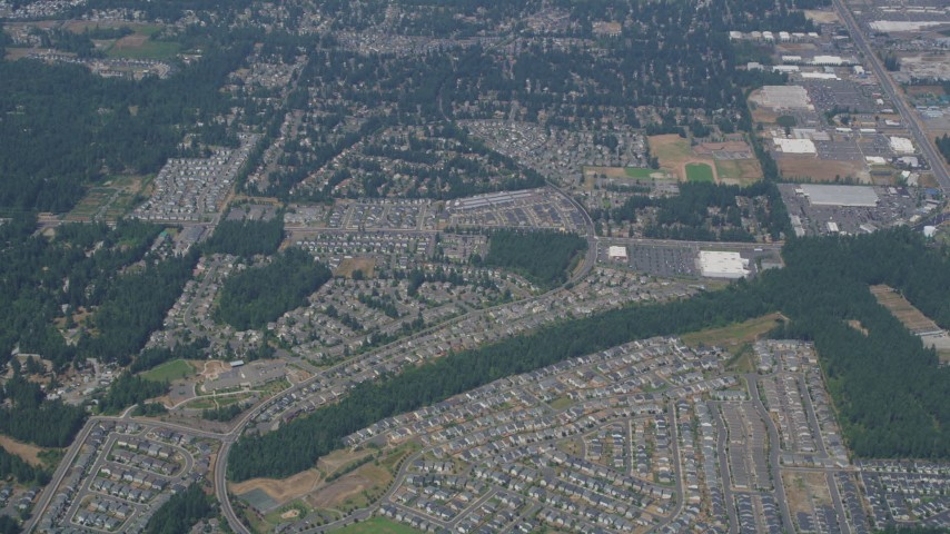 5K aerial video of reverse view of suburban neighborhoods in Renton, Washington Aerial Stock Footage AX52_005