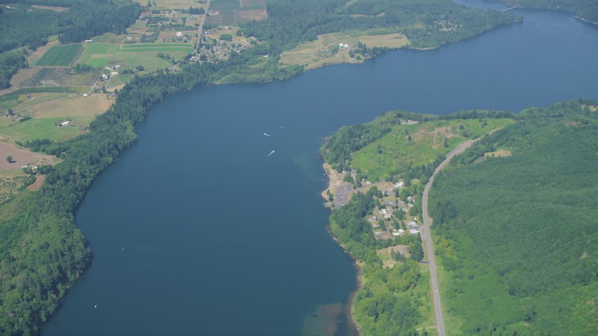 5K stock footage aerial video of reverse view of boats in Mayfield Lake, rural homes on shore, Washington Aerial Stock Footage | AX52_017
