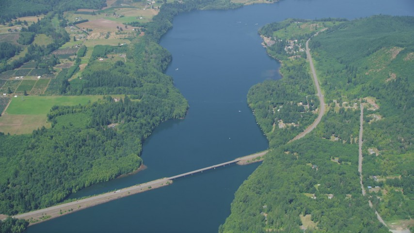 5K stock footage aerial video of reverse view of Mayfield Lake, reveal Highway 12 bridge, Washington Aerial Stock Footage | AX52_018