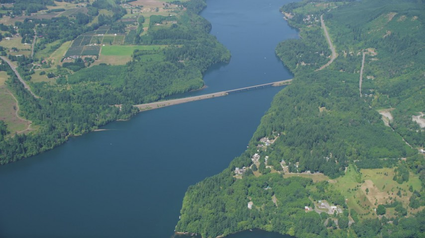 5K stock footage aerial video of reverse view of bridge spanning Mayfield Lake, and reveal lakefront homes, Washington Aerial Stock Footage | AX52_019