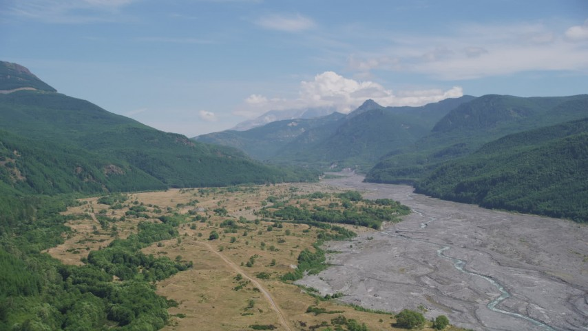 5K stock footage aerial video of follow North Fork Toutle River toward Mt. St. Helens, Washington Aerial Stock Footage | AX52_032