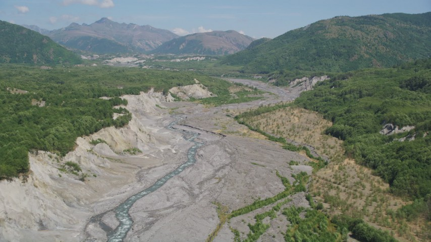 5K stock footage aerial video pan across the sediment in the North Fok Toutle River, Washington Aerial Stock Footage | AX52_037