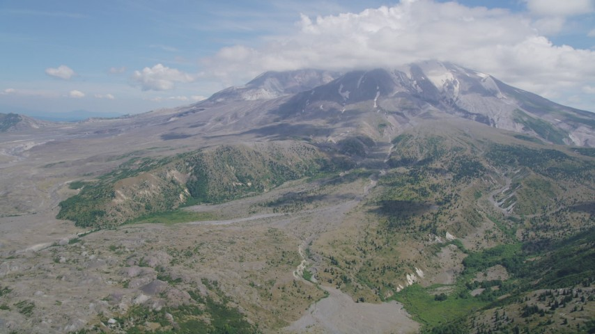 5K stock footage aerial video approach Mount St. Helens and clouds capping the peak, Washington Aerial Stock Footage | AX52_044