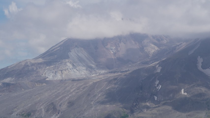 5K aerial video of Mount St. Helens crater with cloud cover, Washington Aerial Stock Footage AX52_045