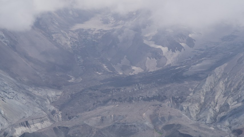 5K stock footage aerial video of a close-up look inside the Mount St. Helens crater with low clouds, Washington Aerial Stock Footage | AX52_048