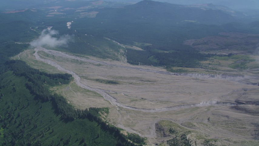 5K stock footage aerial video approach the North Fork Toutle River sediment flow in Washington Aerial Stock Footage | AX52_053