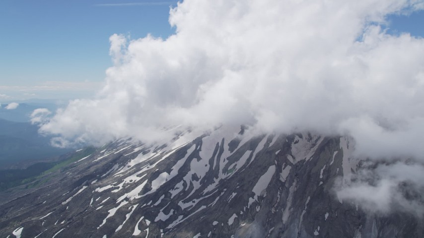 5K aerial stock footage video of snow on the slope of Mount St. Helens and low clouds, Washington Aerial Stock Footage AX52_054