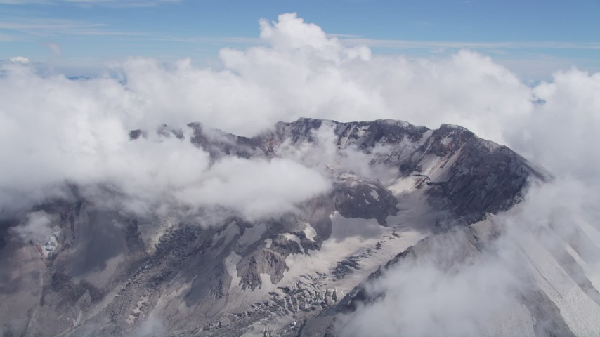 5K aerial video of Mount St. Helens crater ringed by cloud coverage, Washington Aerial Stock Footage | AX52_061
