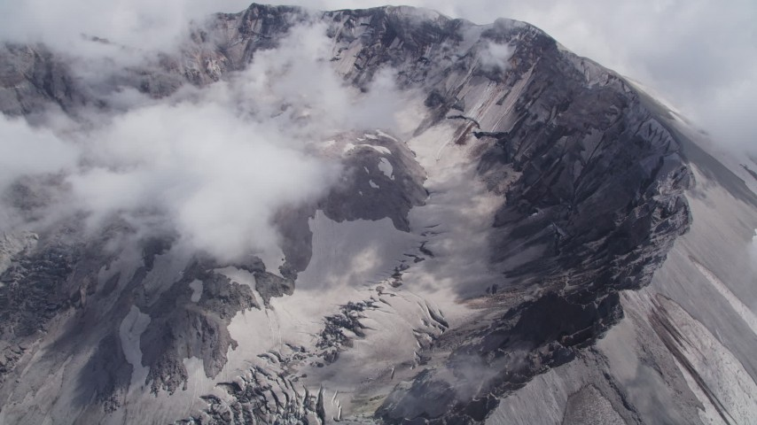5K stock footage aerial video of a view of the Mount St. Helens crater with low hanging clouds, Washington Aerial Stock Footage | AX52_063