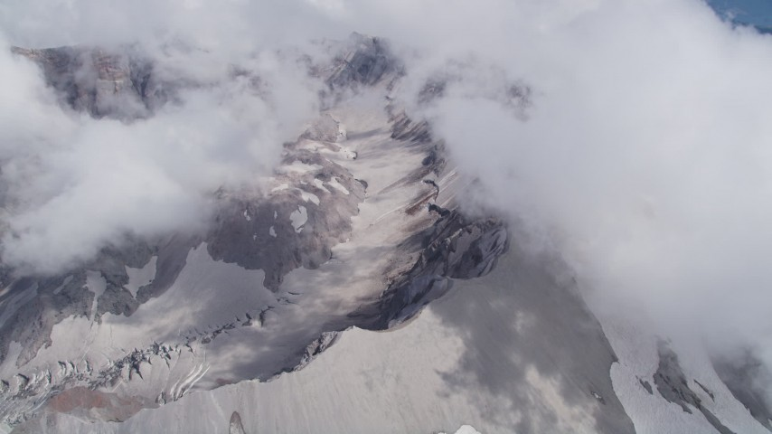 5K aerial video pan across and flyby the Mount St. Helens crater and clouds, Washington Aerial Stock Footage | AX52_064
