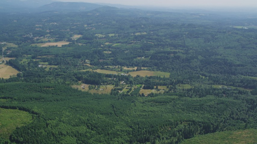 5K stock footage aerial video of small farms surrounded by evergreen forest, Amboy, Washington Aerial Stock Footage | AX52_068