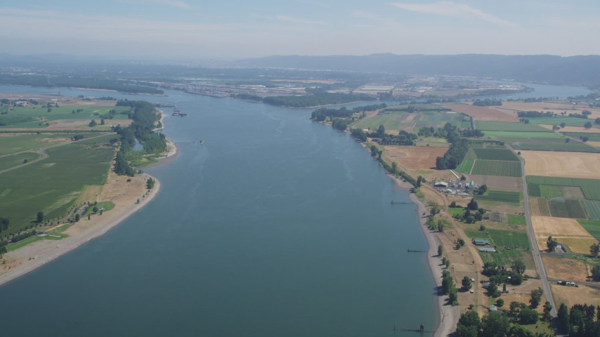 5K stock footage aerial video of Columbia River between Washington and Riverview, Oregon farmland Aerial Stock Footage | AX52_098