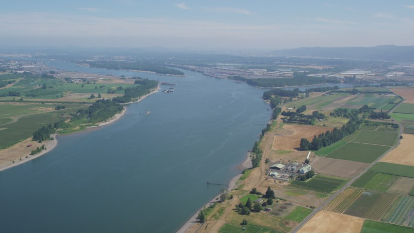 5K stock footage aerial video of Columbia River seen from farms and fields in Riverview, Oregon Aerial Stock Footage AX52_099 | Axiom Images