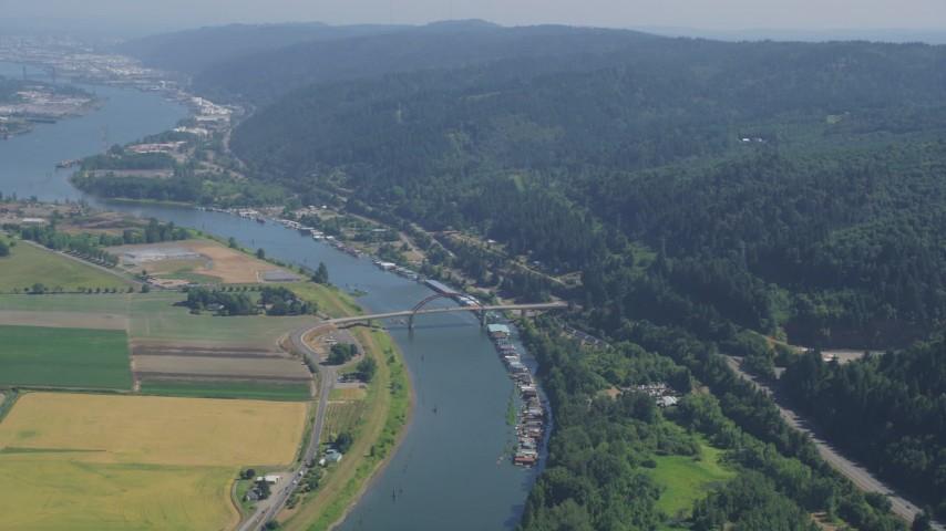 5K stock footage aerial video of the Northwest Sauvie Island Bridge spanning Multnomah Channel near crop fields, Riverview, Oregon Aerial Stock Footage | AX52_105