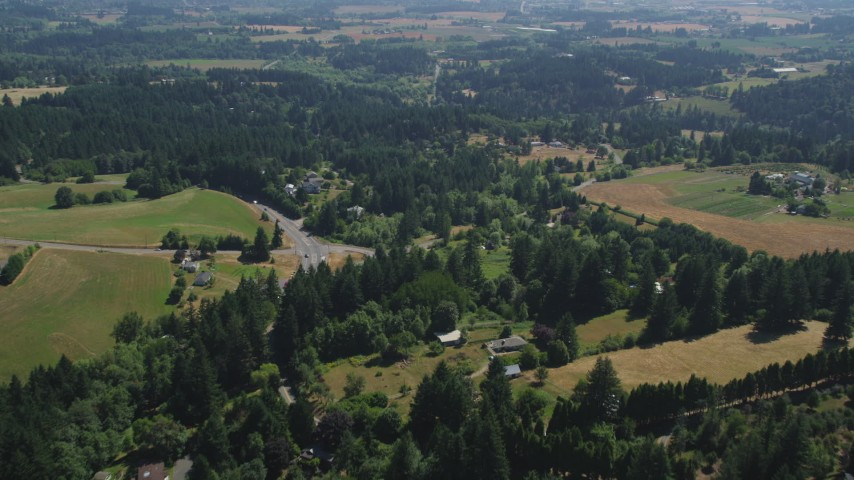 5K stock footage aerial video fly over rural homes and small farms around a country road in Hillsboro, Oregon Aerial Stock Footage | AX52_108