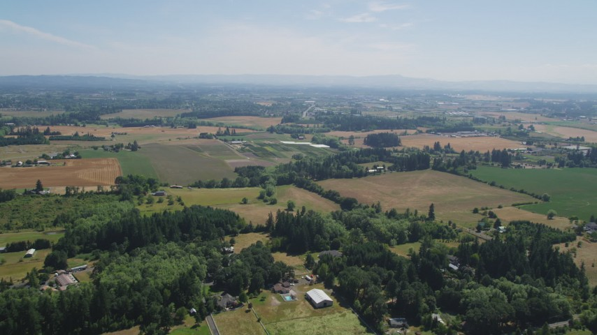 5K stock footage aerial video of flying over farms and fields in Hillsboro, Oregon Aerial Stock Footage | AX52_110