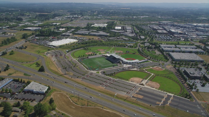 5K stock footage aerial video approach a multi-sport stadium in Hillsboro, Oregon Aerial Stock Footage | AX52_114