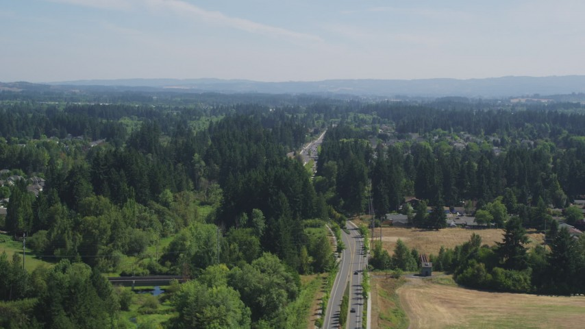 5K stock footage aerial video of road through a suburban neighborhood in Hillsboro, Oregon Aerial Stock Footage | AX52_118