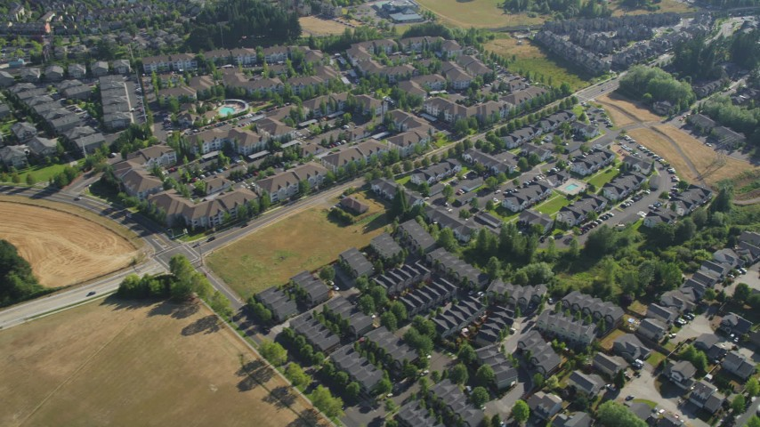 5K aerial video of flying by apartment buildings and residential neighborhoods, Hillsboro, Oregon Aerial Stock Footage | AX53_001