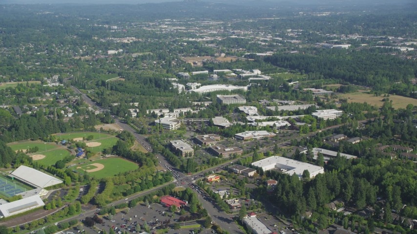 5K stock footage aerial video of approaching Nike Headquarters among trees, Beaverton, Oregon Aerial Stock Footage | AX53_003