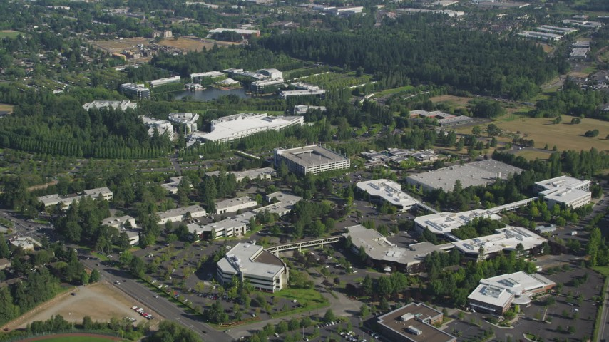 Flying by Nike Headquarters, Beaverton, Oregon Aerial Stock Footage AX53_004