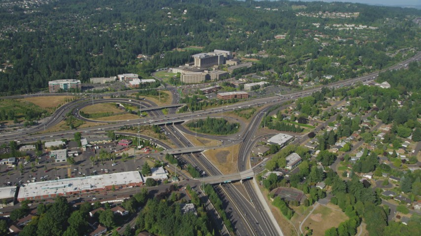 5K stock footage aerial video fly over highways toward a medical center, Southwest Portland, Oregon Aerial Stock Footage | AX53_008