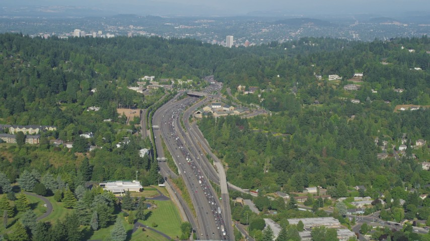 5K stock footage aerial video of following a highway through residential neighborhoods, Southwest Portland, Oregon Aerial Stock Footage | AX53_009