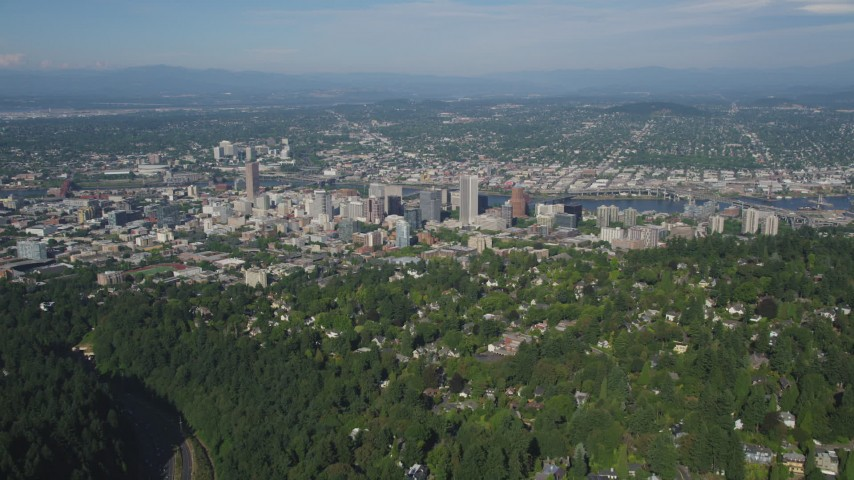 5K stock footage aerial video fly over residential area toward city buildings, Downtown Portland, Oregon Aerial Stock Footage | AX53_014