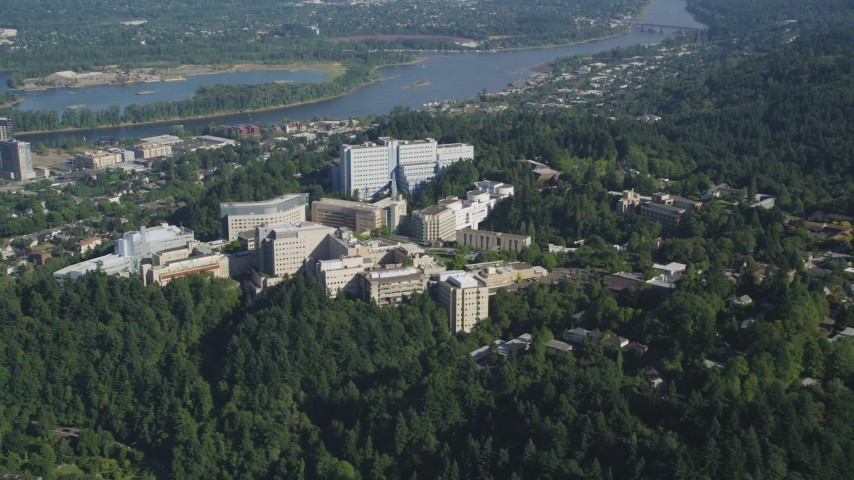 5K stock footage aerial video of Oregon Health and Science University on a tree covered hill, Portland, Oregon Aerial Stock Footage | AX53_015