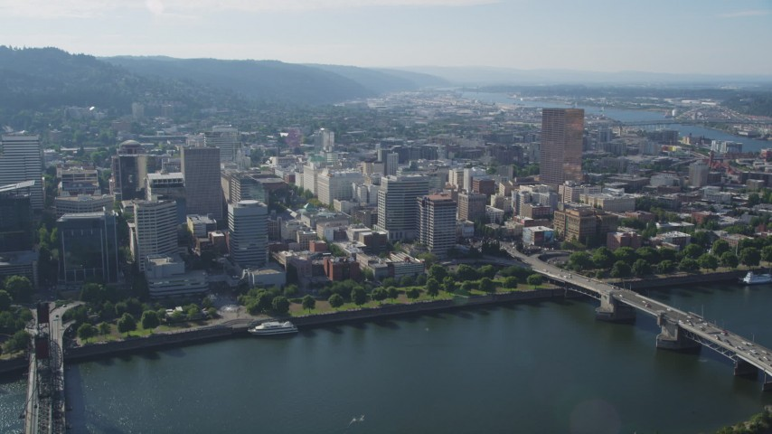 5K stock footage aerial video tilt from Marquam Bridge to reveal downtown buildings from Willamette River, Portland, Oregon Aerial Stock Footage | AX53_018
