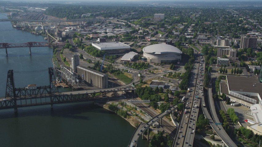 5K stock footage aerial video of approaching the Moda Center from Willamette River, Lloyd District, Northeast Portland, Oregon Aerial Stock Footage | AX53_020