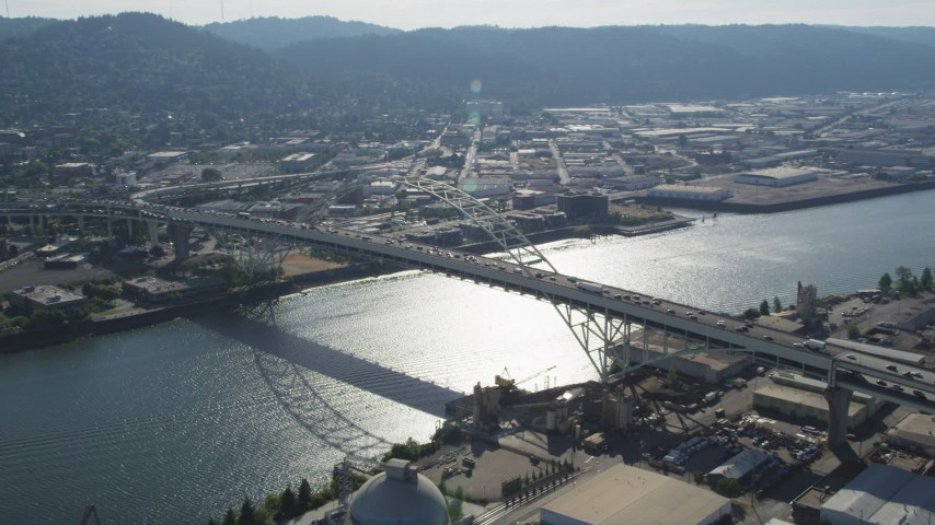 5K stock footage aerial video of orbiting the Fremont Bridge spanning the Willamette River, Portland, Oregon Aerial Stock Footage | AX53_022