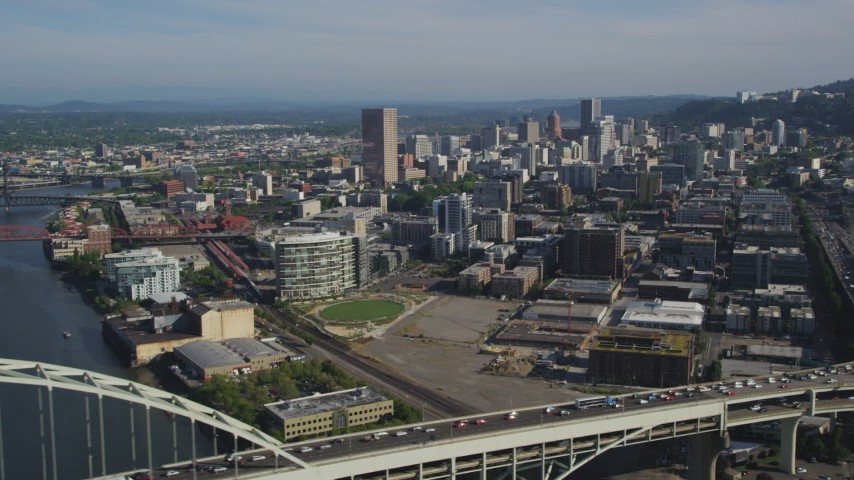 5K stock footage aerial video of orbiting the Fremont Bridge revealing downtown buildings, Downtown Portland, Oregon Aerial Stock Footage | AX53_023