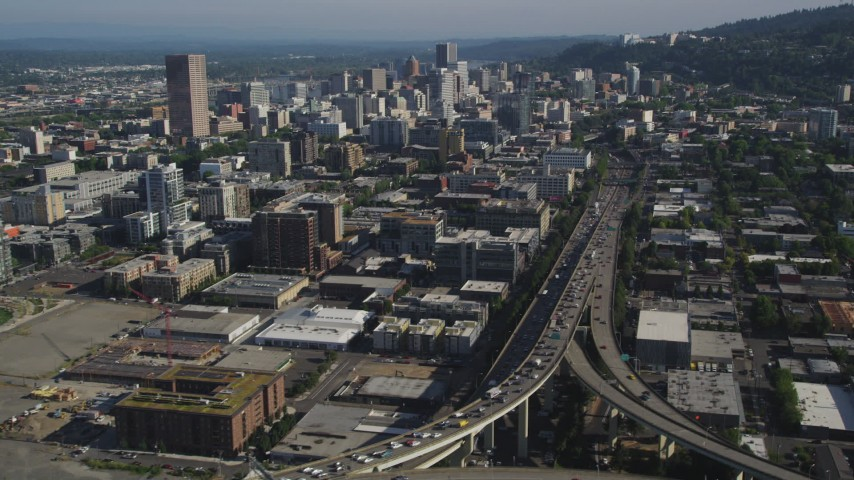 5K stock footage aerial video fly along Interstate 405 and city buildings and skyscrapers, Downtown Portland, Oregon Aerial Stock Footage | AX53_024