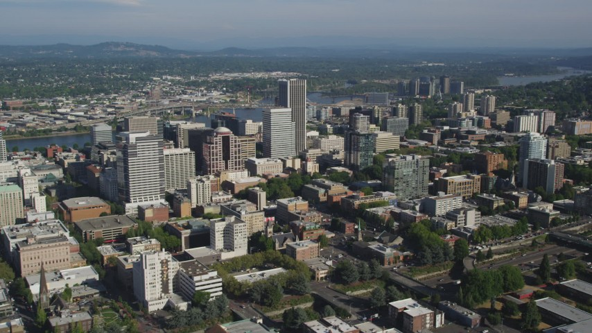 Fly by Downtown skyscrapers and buildings, Portland, Oregon Aerial Stock Footage | AX53_026