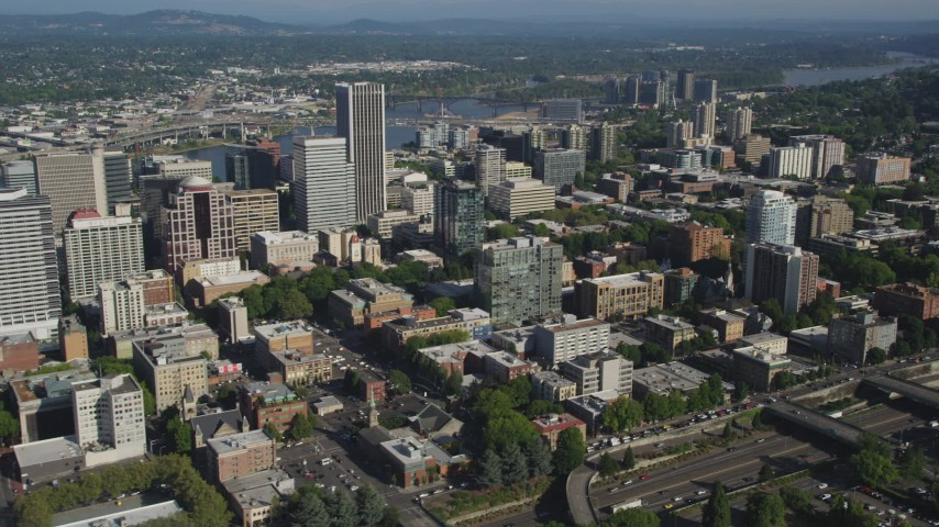 5K stock footage aerial video fly by city skyscrapers and buildings, Downtown Portland, Oregon Aerial Stock Footage | AX53_026