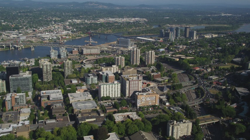 5K stock footage aerial video flyby office and apartment buildings by I-405 in Downtown Portland, Oregon Aerial Stock Footage | AX53_027