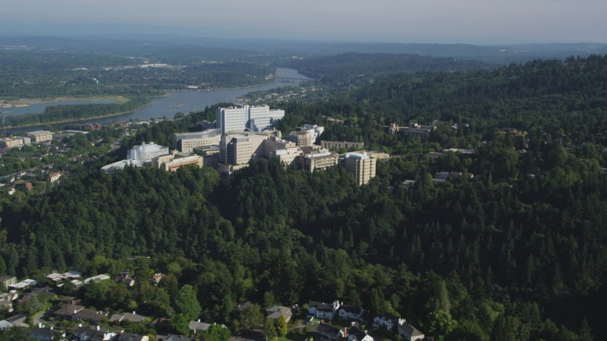 5K aerial video of approaching Oregon Health and Science University, Portland, Oregon Aerial Stock Footage | AX53_028