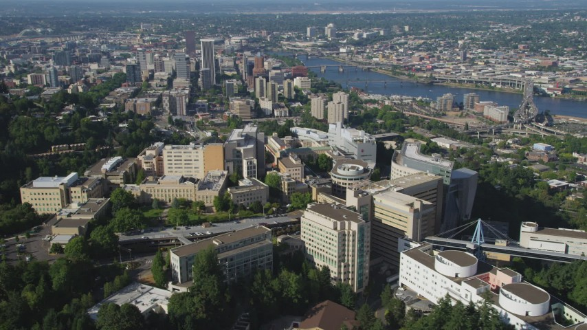 5K stock footage aerial video fly away from Oregon Health and Science University with downtown in the distance, Portland, Oregon Aerial Stock Footage | AX53_030