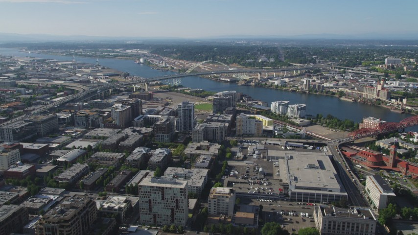 5K stock footage aerial video fly over city buildings toward Fremont Bridge spanning Willamette River, Downtown Portland, Oregon Aerial Stock Footage | AX53_034