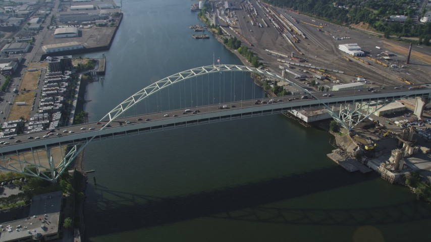 5K stock footage aerial video of orbiting the Fremont Bridge spanning the Willamette River, Portland, Oregon Aerial Stock Footage | AX53_036