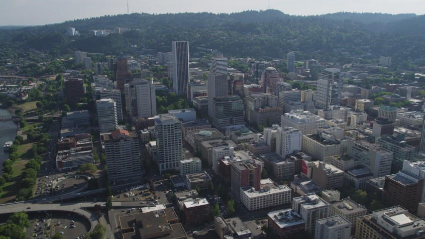 5K stock footage aerial video fly over downtown to approach Wells Fargo Center in Downtown Portland, Oregon Aerial Stock Footage | AX53_040