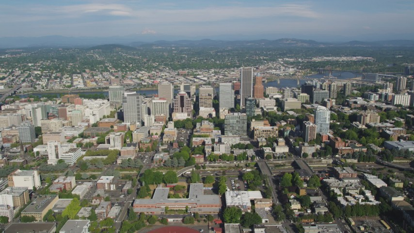 5K aerial video fly by Downtown skyscrapers and buildings, Portland, Oregon Aerial Stock Footage | AX53_044